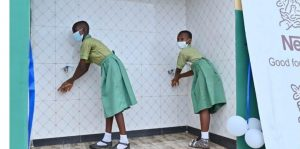Pupils of Salvation Army School 2, Edu, Agbara in Ogun State using the water facility after the commissioning.